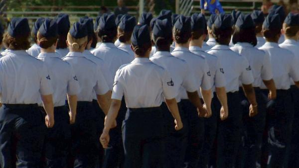 In this June 22 image made from video, female airmen march during graduation at Lackland Air Force Base in San Antonio. A widening sex scandal has rocked Lackland, one of the nation's busiest military training centers. A dozen instructors are being investigated for allegations ranging from abuse to rape.