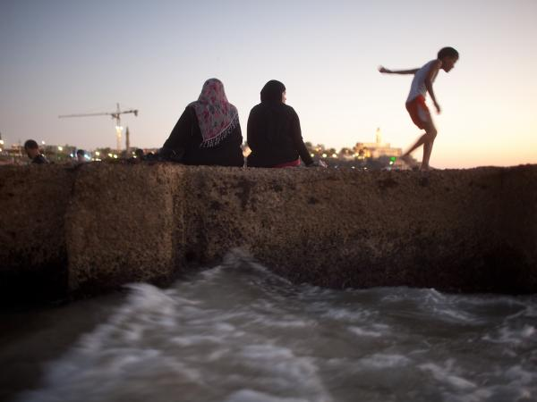 Palestinians enjoy a day at a beach last week. Many West Bank Palestinians allowed into Israel in recent weeks headed to the Mediterranean shore.