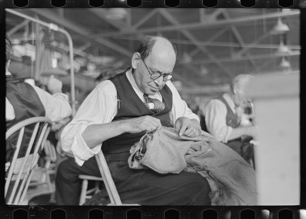 Barry Leving worked as a tailor in the cooperative garment factory in Jersey Homesteads. This town was one of 99 towns set up by the National Industrial Recovery Act in the midst of the economic crisis in the 1930s, and was later renamed Roosevelt, after the president who set up these 'New Deal' towns. The photographs in this slideshow were taken in the early days of the town.
