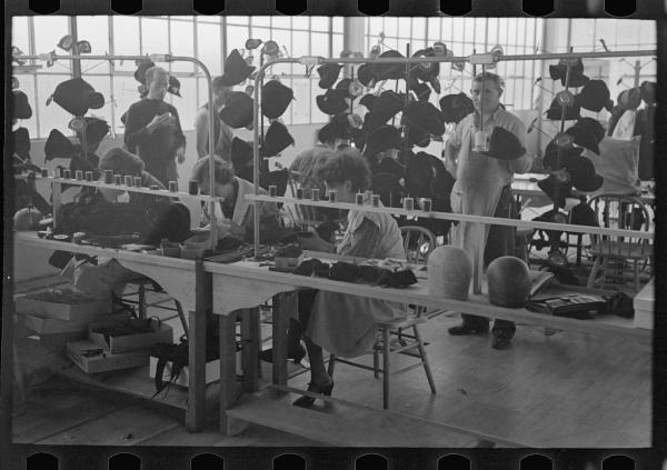 <p>Women at work in the millinery department of the cooperative garment factory.</p><p></p>