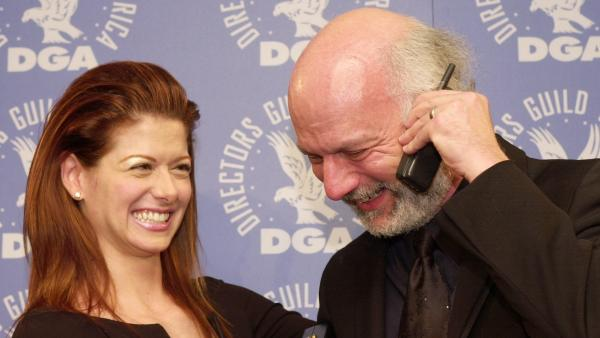 In a 2001 photo, actress Debra Messing and director James Burrows pose together after Burrows won a Directors Guild of America award for directing the pilot of <em>Will & Grace</em>.