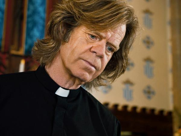Father Brendan (William H. Macy) talks Mark through the ethical and religious questions posed by his arrangement.