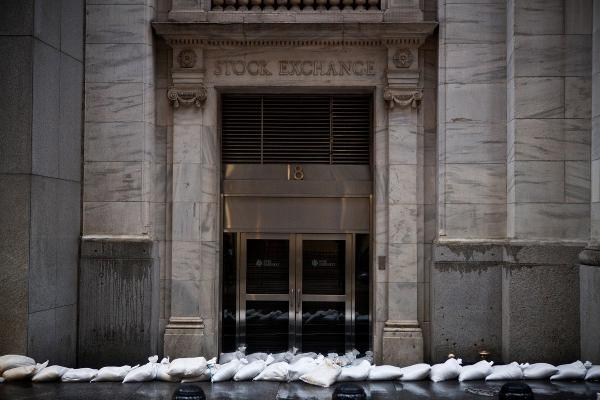 The closed New York Stock Exchange is barricaded with sand bags on Monday. The core of Sandy's force is supposed to hit the New York area Monday night.