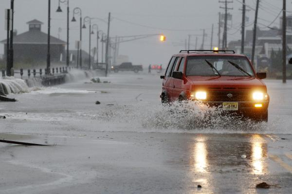 Rough surf breaks over the beach in Cape May, N.J.