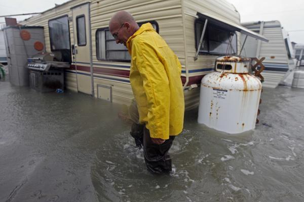 Terry Robinson checks on his flooded trailer at an RV park in Kitty Hawk, N.C. as Hurricane Sandy makes landfall on Monday.