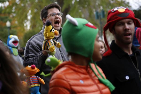 A demonstrator with a puppet of Bert, the Muppet character from <em>Sesame Street</em>, shouts during The Million Muppet March in Washington, D.C., on Saturday. The bipartisan rally was organized to show support for public broadcasting following Republican presidential candidate Mitt Romney's pledge to cut funding to PBS.