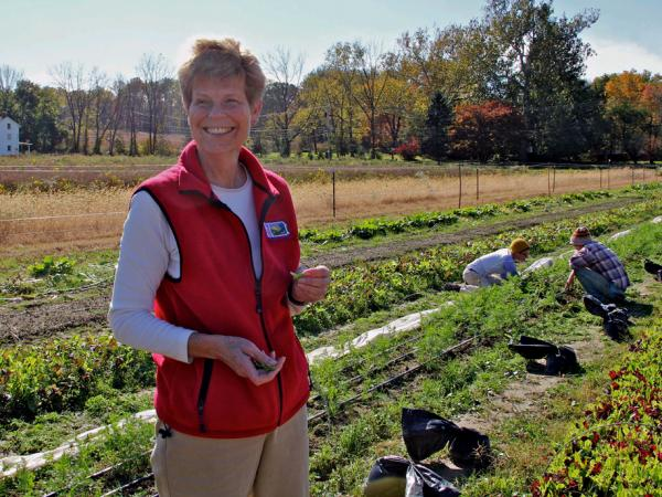 Eleanor Morris Illoway samples greens from farmland that she leased to organic farmers.