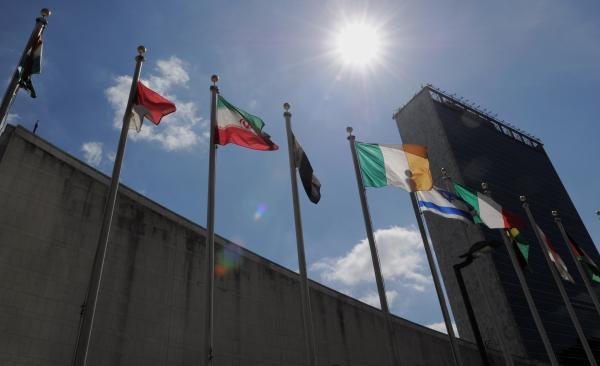 Flags from nations around the world fly outside the U.N. building in New York City. The challenges facing President Obama's foreign policy team will be among the topics of today's national conversation, hosted by <em>Talk of the Nation</em> and the Wilson Center.