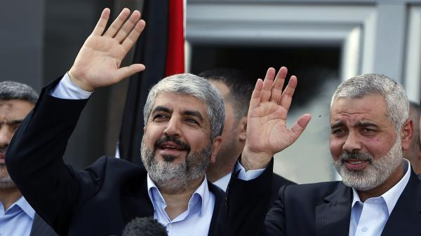 Exiled Hamas chief Khaled Mashaal (left) and Gaza's Hamas Prime Minister Ismail Haniyeh wave during a news conference upon Meshaal's arrival at Rafah crossing in the southern Gaza Strip on Friday.