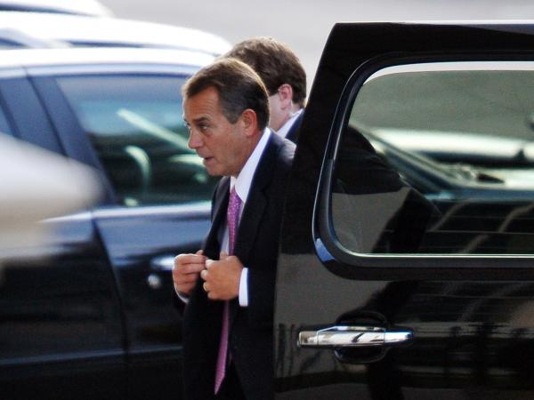 "House Speaker John Boehner arrives at the White House on Friday for talks with President Obama and congressional leaders aimed at avoiding the ""fiscal cliff."""