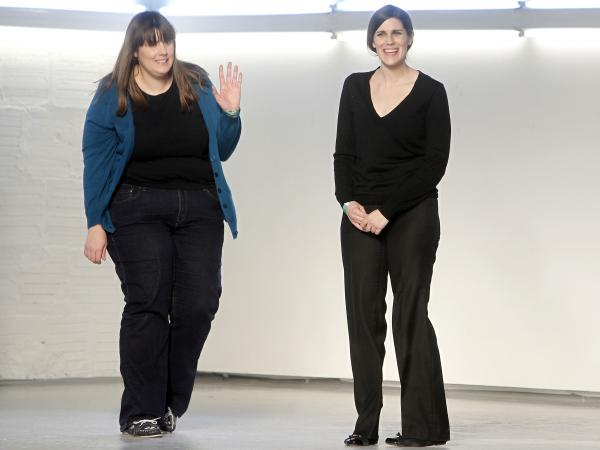 Designers and sisters Kate (left) and Laura Mulleavy acknowledge the audience after the Rodarte fall 2012 collection show during Fashion Week last February in New York.