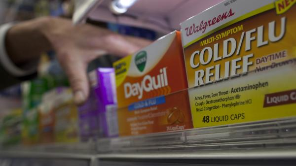 Reaching for relief: A customer at a pharmacy in New York City was grabbing some medicine on Thursday.