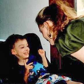 Zach Sayne at age 5, with his mother Nola.