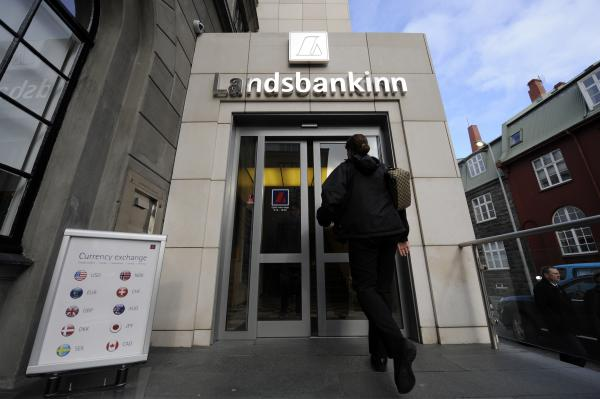 A file picture shows a woman entering a branch of Iceland's second largest bank, Landsbanki (Landsbankinn) on October 8, 2008 in Rejkjavik.