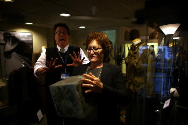 Randall Thropp, a Paramount archivist, recoils in mock fear from the power of the AllSpark as set decorator Rosemary Brandenburg takes it from the glass case. The AllSpark was used as a prop in <em>Transformers; </em>it may have another life in an upcoming sequel.