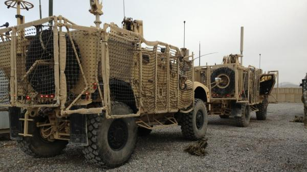 A pair of mine-resistant, ambush-protected vehicles are lined up for a convoy to Kandahar Airfield. One of the trucks broke down before leaving Forward Operating Base Frontenac. The unit has to move out 50 vehicles from the compound.