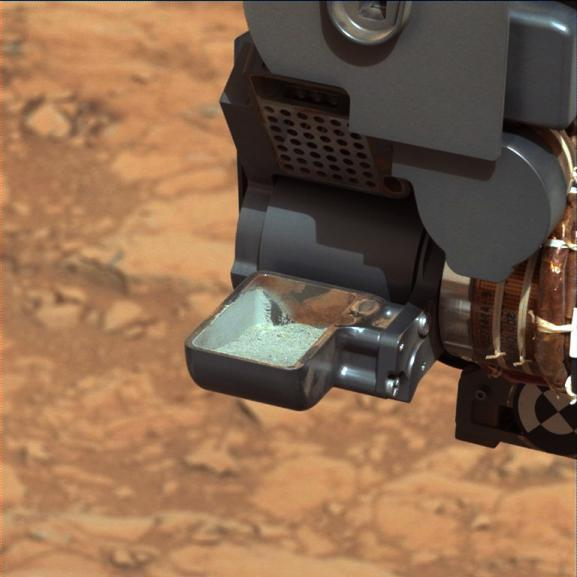 This image from NASA's Curiosity rover shows the first sample of powdered rock extracted by the rover's drill.