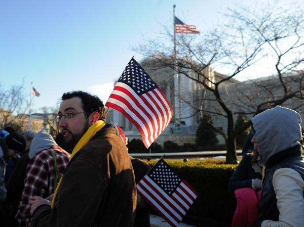 People line up in front of the U.S. Supreme Court on Tuesday before the justices hear arguments in the first of two same-sex marriage cases.