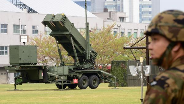 Japan is on full alert ahead of an expected mid-range missile launch by North Korea, its defense minister said as the U.N. warned of a potentially 'uncontrollable' situation. A Japanese soldier walks past a missile launcher deployed in Tokyo.