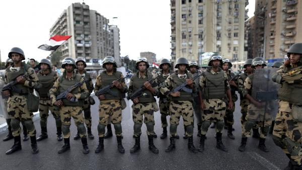 Military special forces surround supporters of President Mohammed Morsi in Cairo on Wednesday. A few hours later, the military ousted Morsi and suspended the constitution.