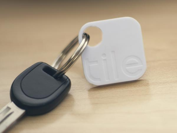 The Tile, accompanied by an iPhone app, locates items that are attached to it. It's about as small as a matchbook or a stamp.