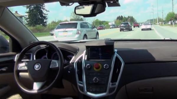 Carnegie Mellon's autonomous car, developed with General Motors, is by all appearances a normal Cadillac SRX crossover — except for the big red button in the middle of the dashboard. In an emergency, the button allows the car to be switched immediately back to standard driving mode.