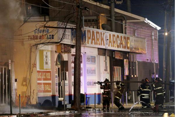 Firefighters battle a blaze on the Seaside Park boardwalk Thursday in New Jersey. The fire began in the vicinity of an ice cream stand and quickly spread north into neighboring Seaside Heights.