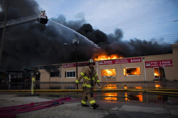 The fire Thursday engulfed several blocks of boardwalk and businesses in an area that was still rebuilding from damage caused by Sandy.