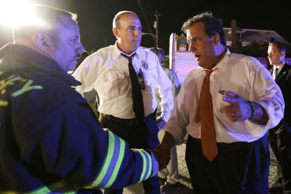 New Jersey Gov. Chris Christie speaks with state fire marshal Bill Kramer (center) and shore regional fire coordinator Craig Augustoni during a visit to the area.