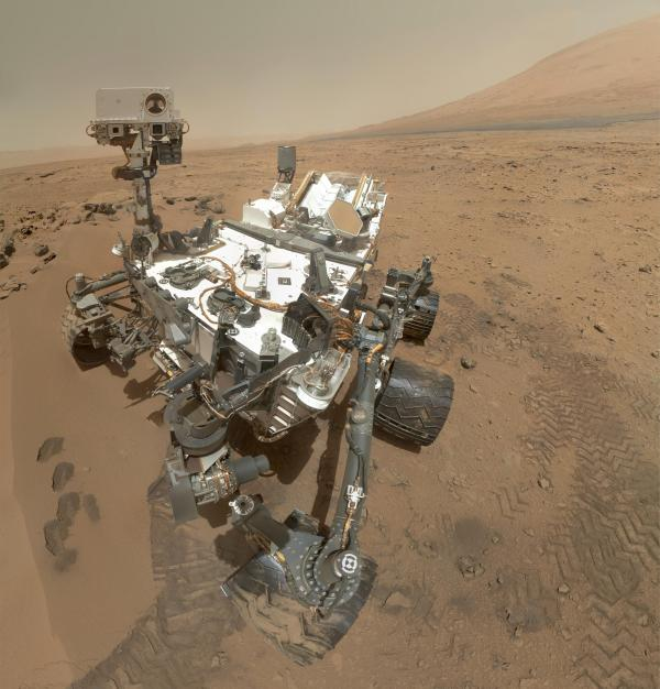 A self portrait mosaic of the Mars Curiosity Rover inside the Gale Crater.
