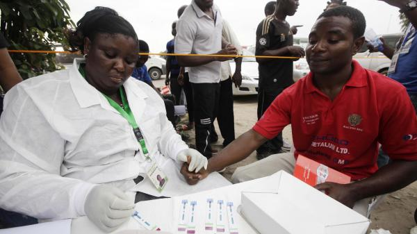A doctor takes an HIV test from an athlete during the 18th National Sports Festival in Lagos, Nigeria, last December.