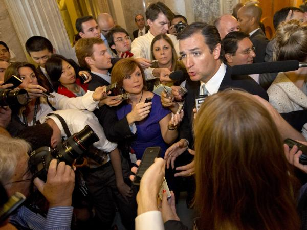 Republican Sen. Ted Cruz speaks to the media Wednesday after delivering a marathon Senate floor speech.