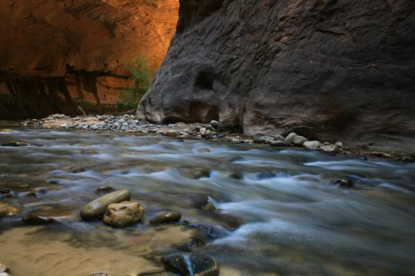 The Virgin River Narrows in Zion National Park is a popular fall hike for thousands of visitors but the government shutdown has closed the park and drained tourism revenue and tax payments from local communities.