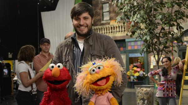 <em>Sesame Street</em> music director Bill Sherman with Elmo and Zoe on the set. Sherman won a Tony Award for <em>In the Heights</em> in 2008 and has recruited Broadway peers to compose for the children's show.
