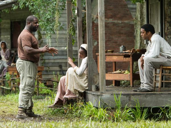 Director Steve McQueen (left) works with actors on the set of <em>12 Years A Slave</em>. The film was shot on a Louisiana plantation that sits next door to where Solomon Northup spent his years as a slave.