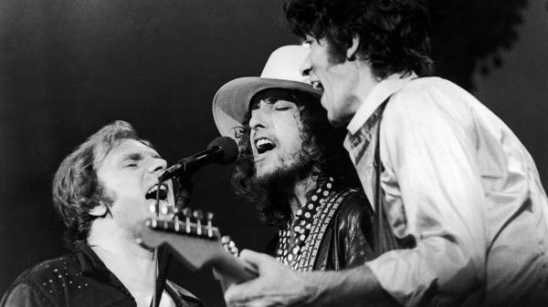 Van Morrison, Bob Dylan and The Band's Robbie Robertson (from left to right) onstage in 1976. The performance was filmed for Martin Scorsese's <em>The Last Waltz</em>.