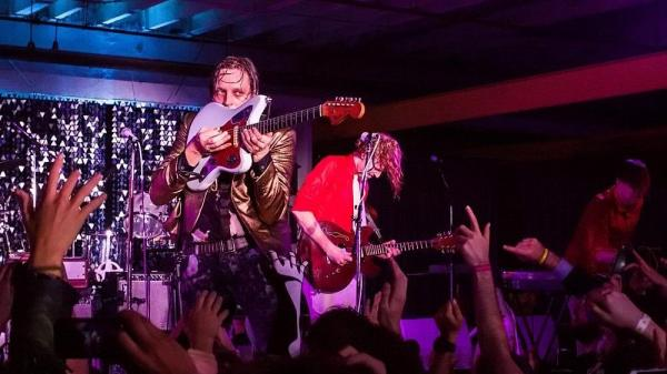 Arcade Fire on Saturday night in Bushwick. Win Butler on the left, Richard Reed Parry on the right.