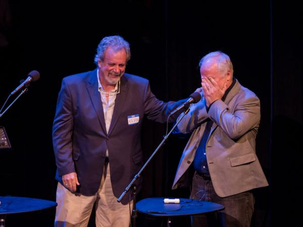 "Kevin Murphy (left) comforts Bill Corbett after Bill incorrectly guessed that ""War With The Mutant Spider Ants"" was a movie title. (It's a <em>Choose Your Own Adventure </em>book, naturally.)"