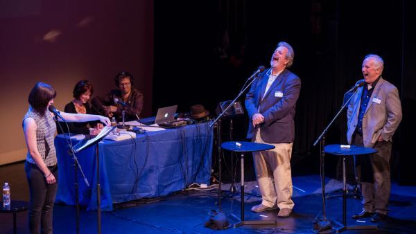 Bill Corbett (right) and Kevin Murphy, of RiffTrax, play a round at the Fitzgerald Theater in St. Paul, Minn.