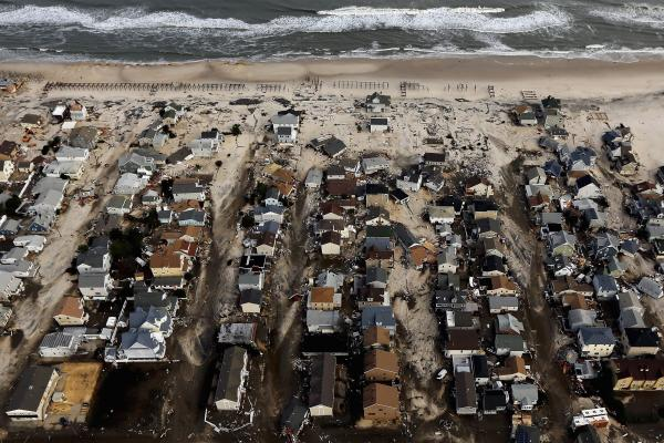 Sand and debris surround homes in Seaside Heights, N.J., Oct. 31, 2012.