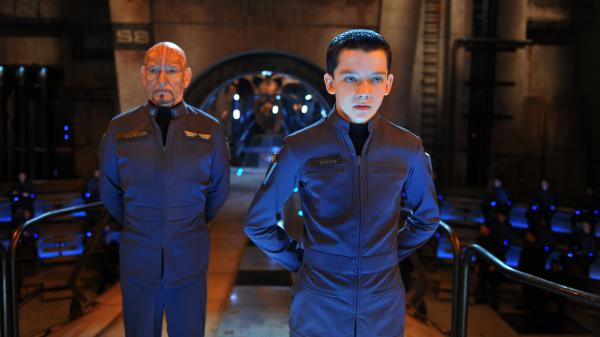 Ender (Asa Butterfield) is a prodigy military cadet being trained by a team of adults — including Mazer Rackham (Ben Kingsley) — to fend off a hostile alien race in a much-discussed adaptation of <em>Ender's Game.</em>