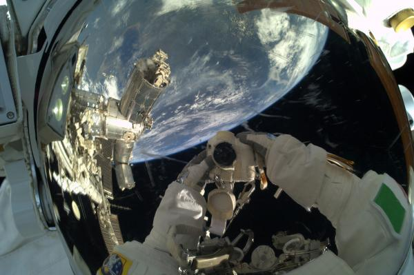 "Parmitano's ""selfie"" in a spacesuit. Columbus, the research laboratory at the International Space Station, is visible in the reflection."