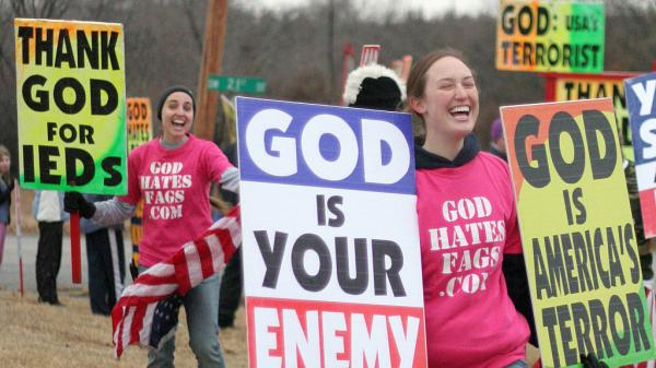 Westboro Baptist Church members hold a protest in Topeka, Kan., in this photo from the Showtime documentary <em>Fall From Grace</em>.