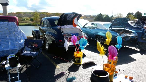"Cars decorated for Halloween wait for kids to come by for ""trunk-or-treating"" in New Berlin, Wis. The event is seen as an alternative to sending kids door to door for candy."