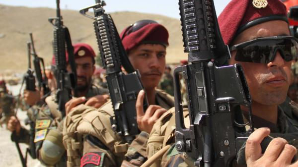 Afghan National Army Commandos attend their graduation ceremony in Kabul in July. Foreign combat troops are set to leave Afghanistan by the end of 2014 after handing over all security responsibilities to Afghan forces.