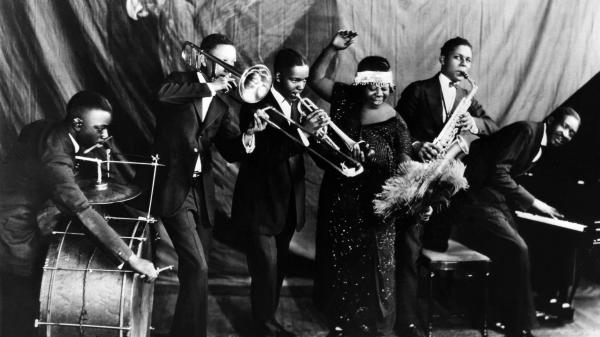 Ma Rainey Georgia Jazz Band posing for a studio group shot in the mid-1920s, with Thomas A. Dorsey at the piano.