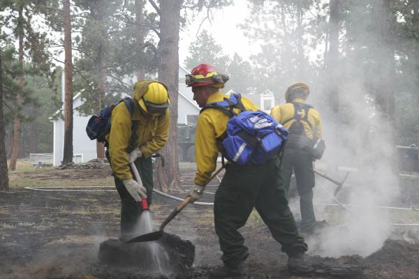 Soldiers from the Colorado National Guard's 1157th Engineer Firefighter Company smother hot spots around Black Forest residential areas in Colorado Springs, Colo., June 14, 2013.