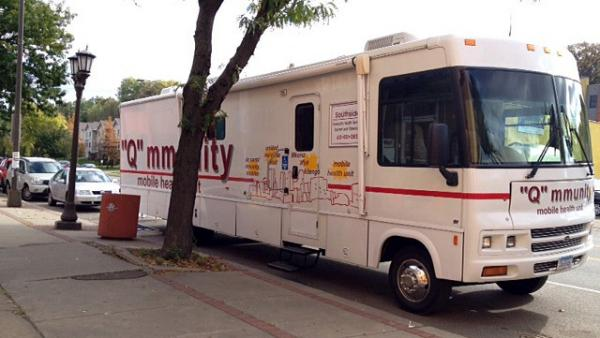 A mobile unit from Southside Community Health Services offers screenings and flu shots and shares information about the state health exchange, MNsure.