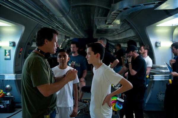 "Director and Screenwriter Gavin Hood talks with Asa Butterfield, who plays Ender, on the set of ""Ender's Game."" (Richard Foreman Jr., SMPSP © 2013 Summit Entertainment, LLC. All Rights Reserved.)"