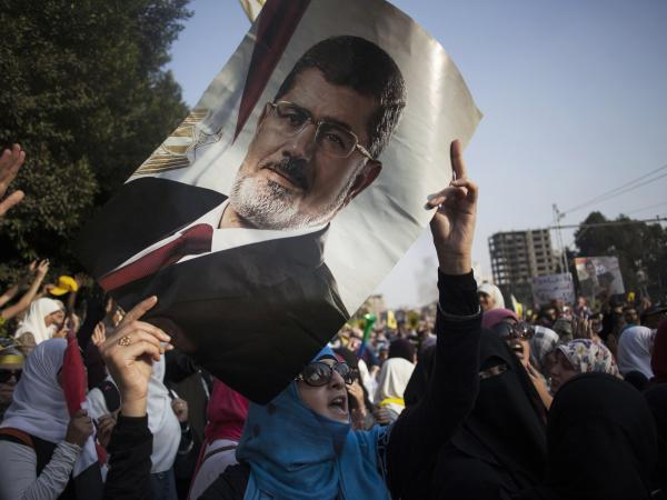 An Egyptian woman holds a portrait of ousted Egyptian President Mohammed Morsi during a protest in Nasr City in Cairo on Friday.